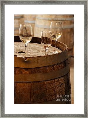 Wine Glasses On An Old Wine Barrel  Framed Print by Michael Gray