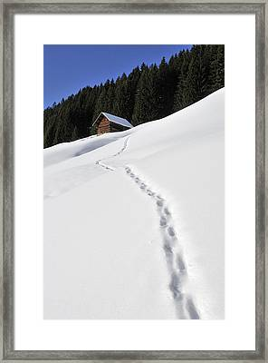 Winter Landscape - Footprints In The Snow Leading To A Barn Framed Print by Matthias Hauser