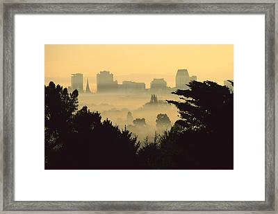 Winter Smog Over The City Framed Print by Colin Monteath