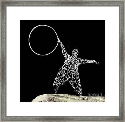 Wire Lady Holding Hoop Framed Print by Tommy  Urbans