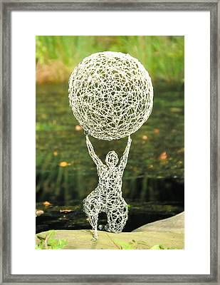 Wire Woman Holding A Ball Framed Print by Tommy  Urbans