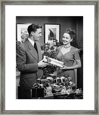 Woman Giving Gift To Man, (b&w) Framed Print by George Marks
