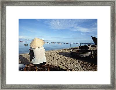 Woman In Conical Hat Sitting On Boat On Framed Print by Axiom Photographic