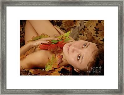 Woman In Fallen Leaves Framed Print by Oleksiy Maksymenko