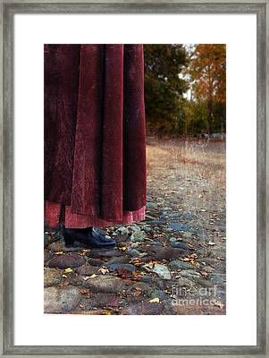 Woman In Vintage Clothing On Cobbled Street Framed Print by Jill Battaglia