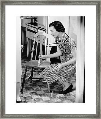 Woman Painting Chair Framed Print by George Marks