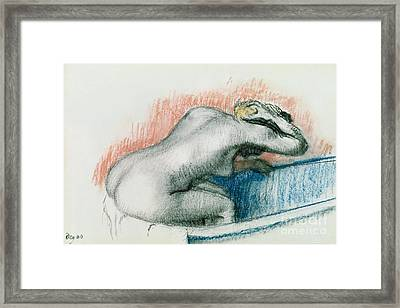Woman Washing In The Bath Framed Print by Edgar Degas