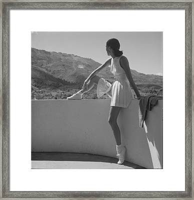 Woman Wearing Tennis Outfit, Seated Framed Print by Everett
