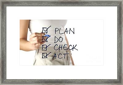Woman Writing Plan Do Check Act Framed Print by Blink Images