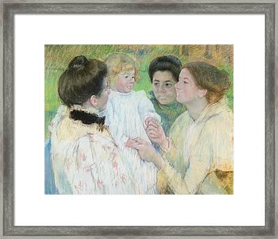 Women Admiring A Child Framed Print by Mary Stevenson Cassatt