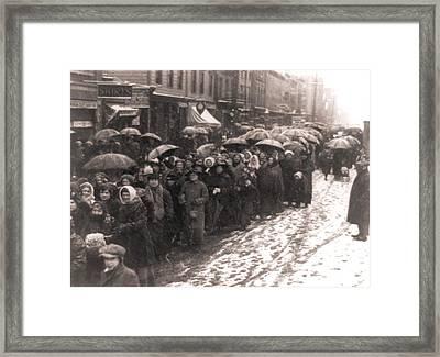 Women Walking Through Snow And Slush Framed Print by Everett