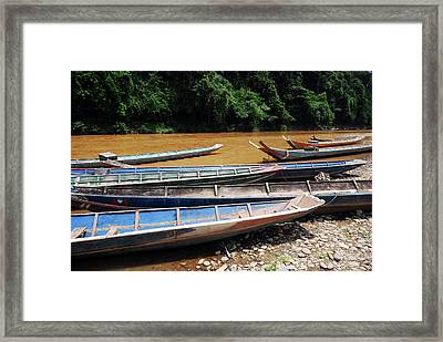 Wooden Boat On River In Laos Framed Print by Thepurpledoor