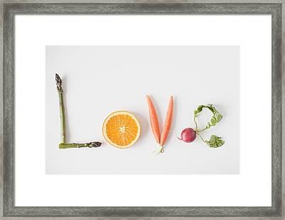 Word 'love' Made Out Of Fruits And Vegetables, Studio Shot Framed Print by Jessica Peterson