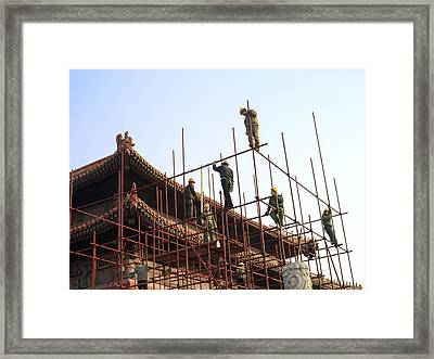 Workers Climb Scaffolding On The Palace Framed Print by Justin Guariglia