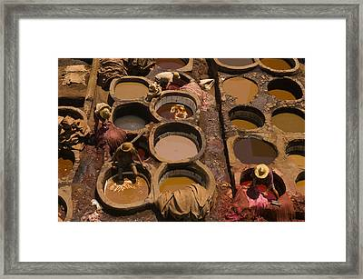 Workers In The Tanneries Of Fez Soak Framed Print by Annie Griffiths