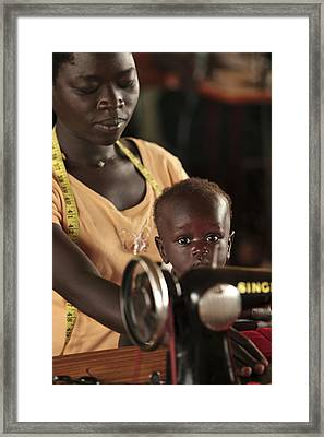 Working Mother And Child, Uganda Framed Print by Mauro Fermariello