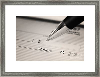 Writing A Check Framed Print by Blink Images