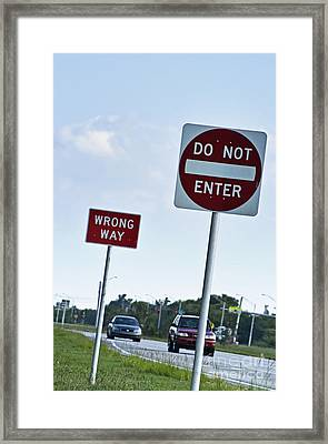 Wrong Way  Framed Print by Blink Images