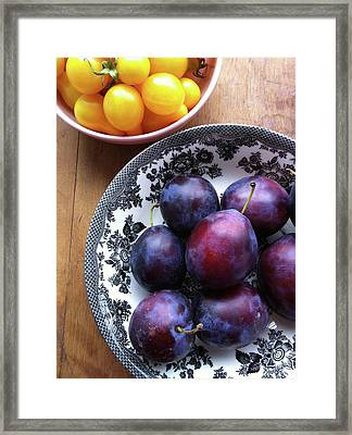 Yellow Cherry Tomatoes And Plums Framed Print by Laura Johansen