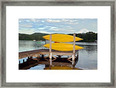 Yellow Kayaks Framed Print by Susan Leggett