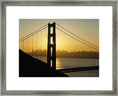 Yellow Sunrise Behind The Golden Gate Framed Print by Axiom Photographic
