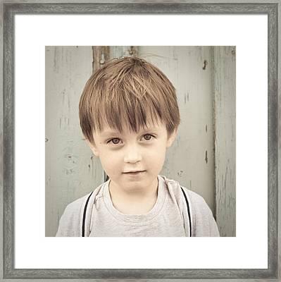Young Boy Framed Print by Tom Gowanlock