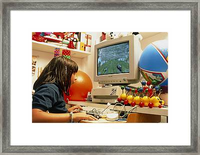 Young Girl Using A Brain-activated Computer System Framed Print by Mauro Fermariello