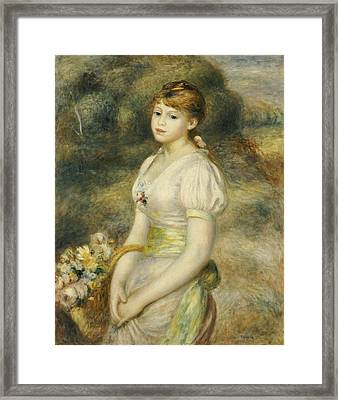 Young Girl With A Basket Of Flowers Framed Print by Pierre Auguste Renoir