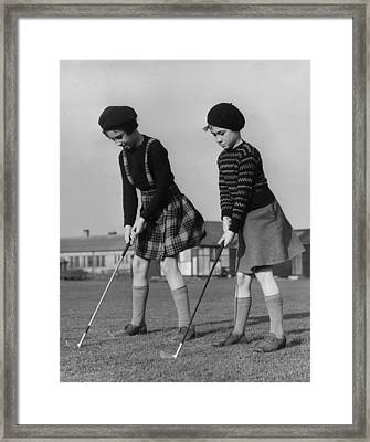Young Golfers Framed Print by Fred Morley