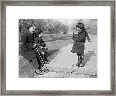 Young Street Photographer Framed Print by Padre Art