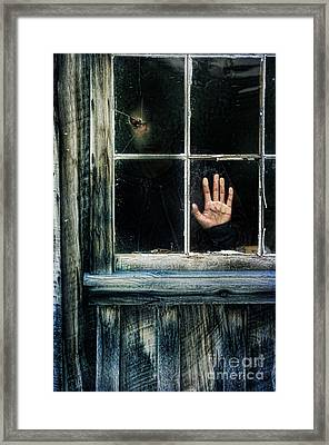Young Woman Looking Through Hole In Window Framed Print by Jill Battaglia