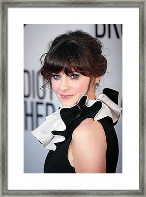 Zooey Deschanel  Wearing A Moschino Framed Print by Everett