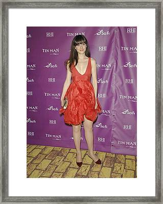 Zooey Deschanel Wearing A Zac Posen Framed Print by Everett