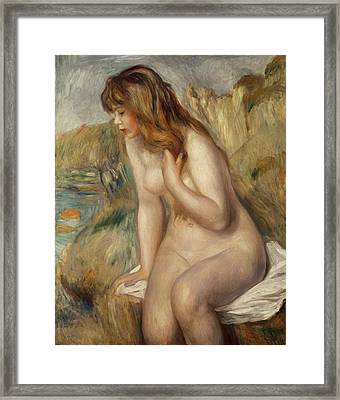 Bather Seated On A Rock Framed Print by Pierre Auguste Renoir