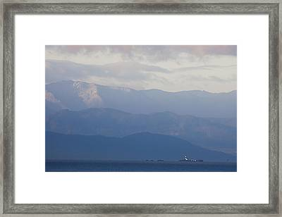 A Lighthouse At Sunset With The Olympic Framed Print by Taylor S. Kennedy