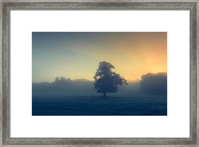 A Misty Sunrise Framed Print by Chris Fletcher