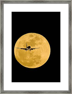 Aeroplane Silhouetted Against A Full Moon Framed Print by David Nunuk