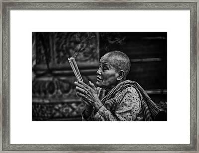 Buddhist Nun Prayers Framed Print by David Longstreath