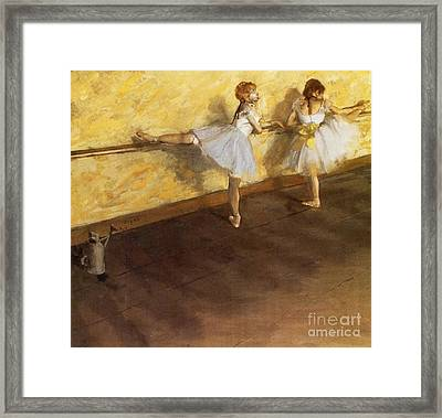 Dancers Practicing At The Barre Framed Print by Edgar Degas