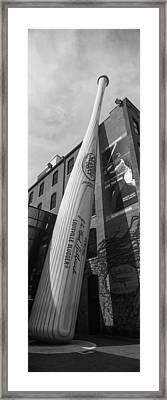Giant Baseball Bat Adorns Framed Print by Panoramic Images