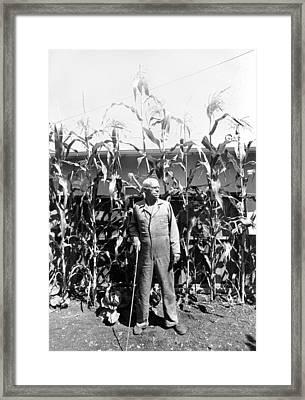 Giant Corn Man Framed Print by Gerhardt Isringhaus