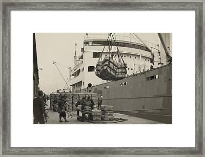 Japanese Longshoremen Loading Bundles Framed Print by Everett