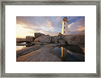Lighthouse At Sunset Framed Print by Richard Nowitz
