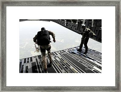 Navy Seals Jump From The Ramp Of A C-17 Framed Print by Stocktrek Images