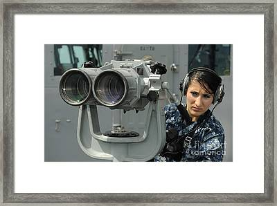 Operations Specialist Looks Framed Print by Stocktrek Images