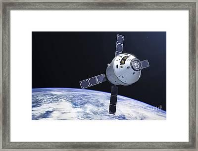 Orion Module In Orbit Above Earth Framed Print by Adrian Mann