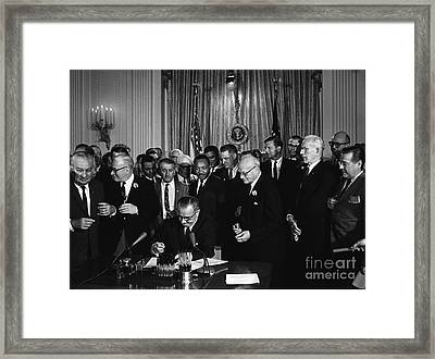 President Johnson Signs Civil Rights Framed Print by Science Source