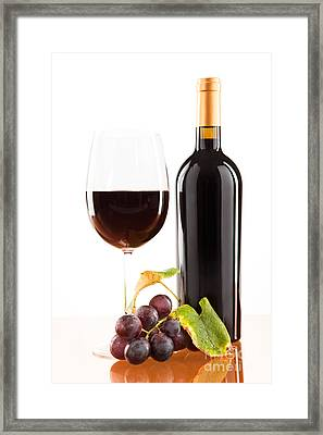 Red Wine In Glass With Bottle And Wine Grapes Framed Print by Wolfgang Steiner