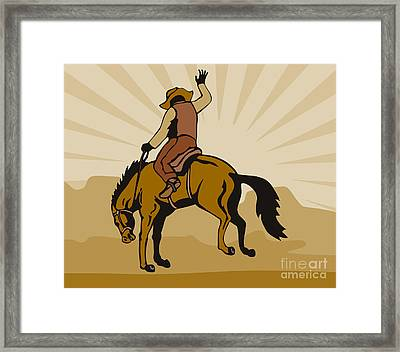 Rodeo Cowboy Bucking Bronco Framed Print by Aloysius Patrimonio