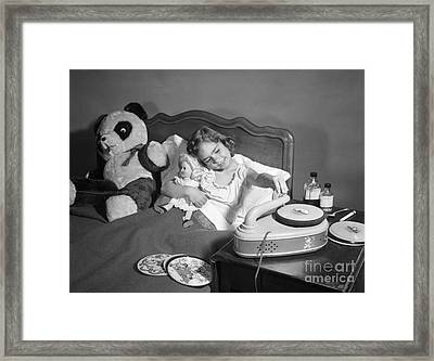 Sick Girl Playing Records, C.1950s Framed Print by Debrocke/ClassicStock